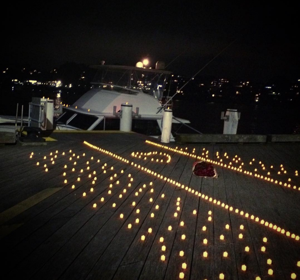 Wedding proposal on boat with electric candles